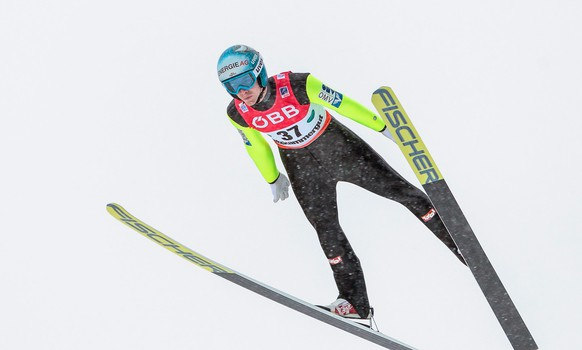 epa05103679 Michael Hayboeck of Austria competes in the second round of the Ski Flying World Championships as part of the FIS Ski Jumping World Cup in Tauplitz - Bad Mitterndorf, Austria, 15 January 2016.  EPA/EXPA/JFK