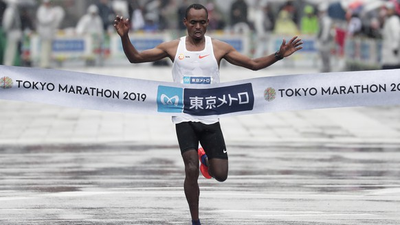 epaselect epa07410132 Birhanu Legese of Ethiopia crosses the finish line to win the men's race of the Tokyo Marathon 2019 in Tokyo, Japan, 03 March 2019. Some 38,000 runners participated in the Tokyo Marathon, one of the six races in the World Marathon Majors (WMM).  EPA/KIYOSHI OTA