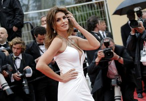 Model Cindy Crawford arrives for the opening ceremony and the screening of The Great Gatsby at the 66th international film festival, in Cannes, southern France, Wednesday, May 15, 2013. (AP Photo/Francois Mori)