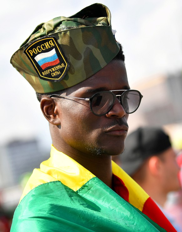 epa06820891 A Senegalese supporter arrives for the FIFA World Cup 2018 group H preliminary round soccer match between Poland and Senegal in Moscow, Russia, 19 June 2018.  EPA/BARTLOMIEJ ZBOROWSKI POLAND OUT