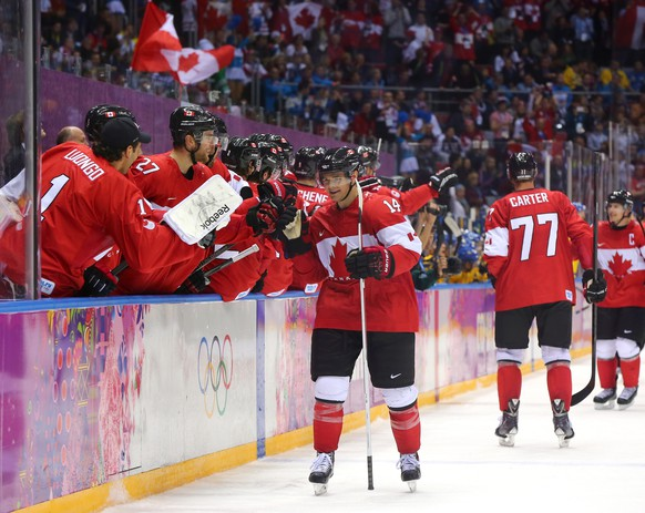 SOCHI, RUSSIA - FEBRUARY 23:  Chris Kunitz #14 of Canada celebrates with teammates after scoring his team's third goal in the third period during the Men's Ice Hockey Gold Medal match against Sweden on Day 16 of the 2014 Sochi Winter Olympics at Bolshoy Ice Dome on February 23, 2014 in Sochi, Russia.  (Photo by Martin Rose/Getty Images)