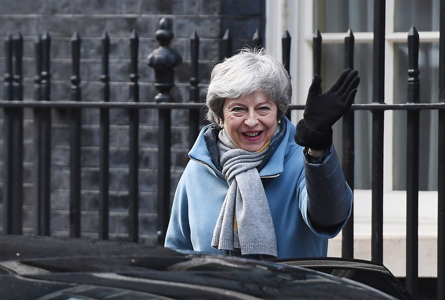 epa07436874 British Prime Minister, Theresa May leaves Downing Street in London, Britain, 14 March 2019. Members of Parliament are set to vote on whether to ask European Union for permission to delay Brexit later in the day after they rejected no-deal Brexit on 13 March.  EPA/ANDY RAIN