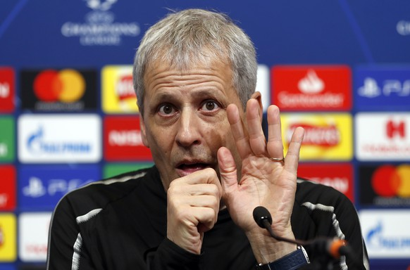 Dortmund coach Lucien Favre gestures during a press conference ahead of the Champions League round of 16 first leg soccer match between Tottenham Hotspur and Borussia Dortmund at Wembley Stadium in London, Tuesday, Feb. 12, 2019.(AP Photo/Frank Augstein)