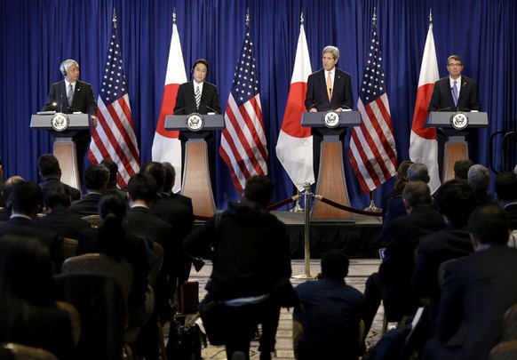 From left, Japanese Defense Minister Gen Nakatani, Japanese Foreign Minister Fumio Kishida, Secretary of State John Kerry and Defense Secretary Ash Carter participate in a news conference in New York, Monday, April 27, 2015. The US and Japan are boosting their defense relationship, allowing Japan to play a bigger role in global military operations with an eye on potential threats from China and North Korea. (AP Photo/Seth Wenig)