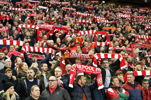 epa07554368 Fans of Liverpool sing You'll never walk alone before the UEFA Champions League semi final 2nd leg match between Liverpool FC and FC Barcelona at Anfield, Liverpool, Britain, 07 May 2019.  EPA/NEIL HALL