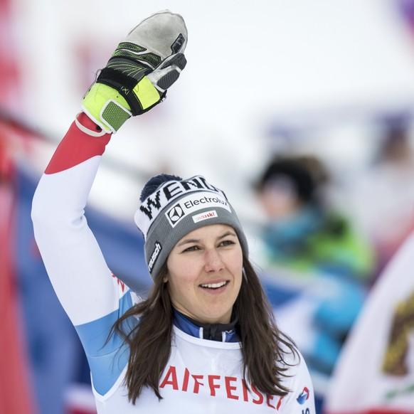 epa06481136 Third placed Wendy Holdener of Switzerland celebrates on the podium for the Women's Slalom race at the FIS Alpine Skiing World Cup in Lenzerheide, Switzerland, 28 January 2018.  EPA/JEAN-CHRISTOPHE BOTT