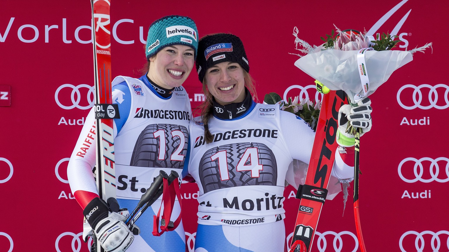 epa06378620 Jasmine Flury, of Switzerland, right, first place, and  Michelle Gisin, left, of Switzerland, second place, celebrate on the podium in the finish area at the women's Super-G race at the FIS Alpine Ski World Cup, in St. Moritz, Switzerland, Saturday, December 9, 2017.  EPA/ALEXANDRA WEY