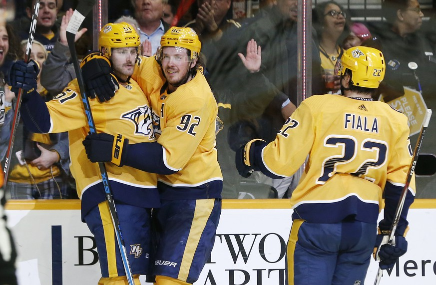 Nashville Predators left wing Austin Watson (51) celebrates with Ryan Johansen (92) and Kevin Fiala (22), of Switzerland, after scoring against the Anaheim Ducks during the second period of an NHL hockey game Sunday, Nov. 25, 2018, in Nashville, Tenn. (AP Photo/Mark Humphrey)