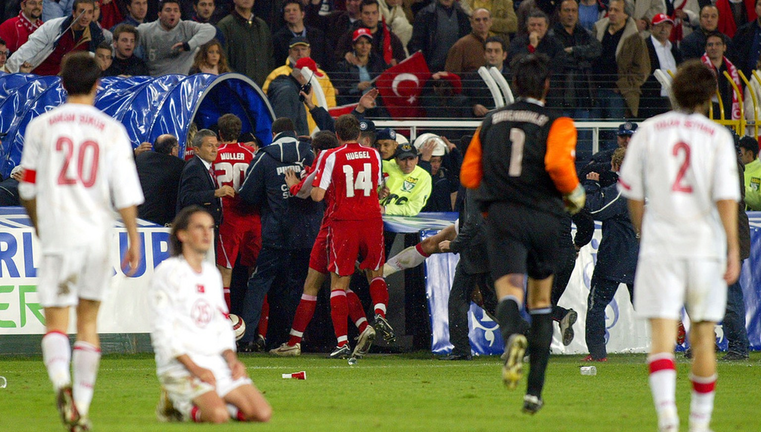 Swiss players, center, leave the field at Sukru Saracoglu Stadium in Istanbul, Turkey, Wednesday, Nov. 16, 2005, at the end of the 2006 World Cup play-off second leg soccer match between Turkey and Switzerland. Turkey won 4-2 but Switzerland advanced for the World Cup finals winning the tie on away goals 4-4. (AP Photo/Osman Orsal)