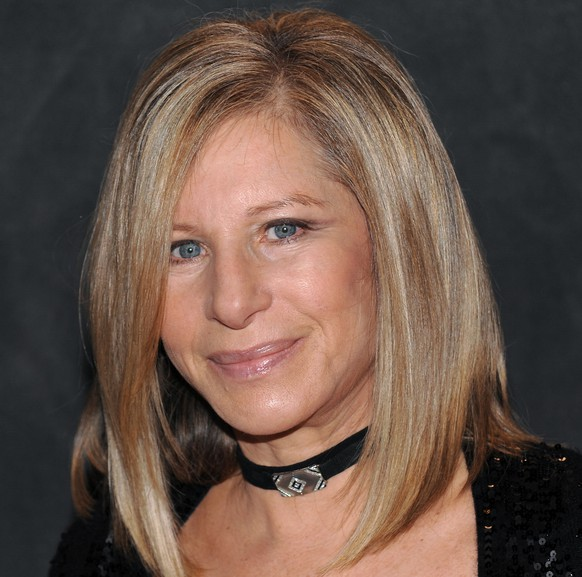 FILE - Singer Barbra Streisand poses for a photo at the Waldorf-Astoria following her performance at the Village Vanguard in this Saturday, Sept. 26, 2009 file photo taken in New York. (AP Photo/Evan Agostini, File)