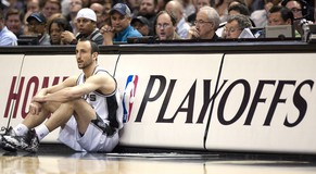 epa04206273 San Antonio Spurs player Manu Ginobili of Argentina waits to be put in the game in the first half of their Conference Semifinal NBA playoff game against the Portland Trail Blazers at the AT&T Center in San Antonio, Texas, USA, 14 May 2014. The winner of the best-of-seven series will go on to face either the Oklahoma City Thunder or the Los Angeles Clippers in the Conference Finals.  EPA/ASHLEY LANDIS CORBIS OUT