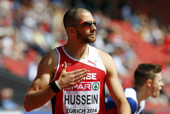 Kariem Hussein of Switzerland reacts after competing in the men's 400 metres hurdles heats during the Zurich 2014 European Athletics Championships at the Letzigrund Stadium in Zurich August 12, 2014. REUTERS/Arnd Wiegmann (SWITZERLAND  - Tags: SPORT ATHLETICS)