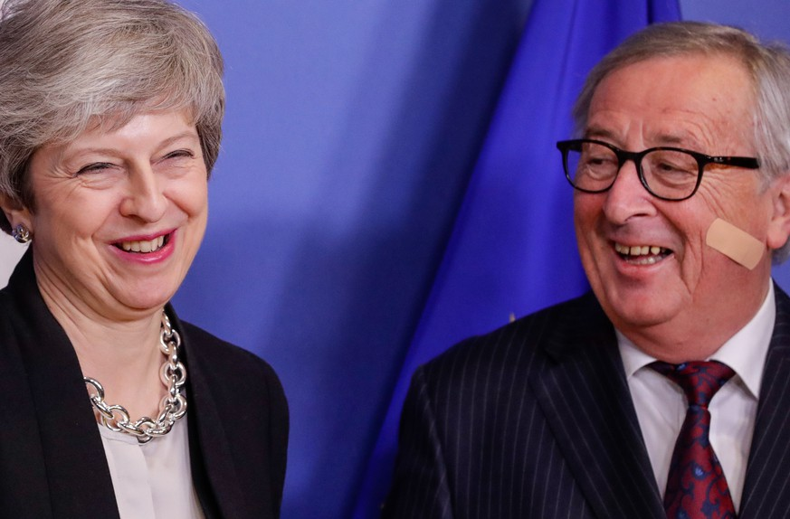 epa07383438 British Prime Minister Theresa May (L) is welcomed by European commission President Jean-Claude Juncker (R) ahead to a meeting on Brexit in Brussels, Belgium, 20 February 2019. May is in Brussels to discuss Brexit and related issues.  EPA/OLIVIER HOSLET