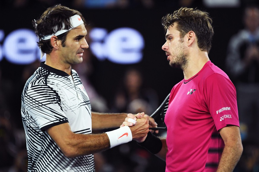 epa05751875 Roger Federer (L) of Switzerland shakes hands with Stan Wawrinka (R) of Switzerland whom he defeated in the Men's Singles semifinal match at the Australian Open Grand Slam tennis tournament in Melbourne, Australia, 26 January 2017.  EPA/TRACEY NEARMY  AUSTRALIA AND NEW ZEALAND OUT