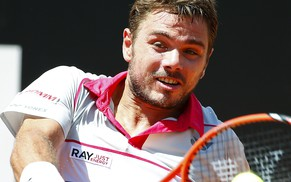 Stan Wawrinka of Switzerland returns the ball to Juan Monaco of Argentina during their match at the Rome Open tennis tournament in Rome, Italy, May 12, 2015. REUTERS/Tony Gentile