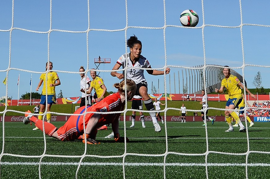 OTTAWA, ON - JUNE 20:  Celia Sasic of Germany scores the third goal past goalkeeper Hedvig Lindahl of Sweden during the FIFA Women's World Cup Canada 2015 Round of 16 match between Germany and Sweden at Lansdowne Stadium on June 20, 2015 in Ottawa, Canada.  (Photo by Dennis Grombkowski/Bongarts/Getty Images)