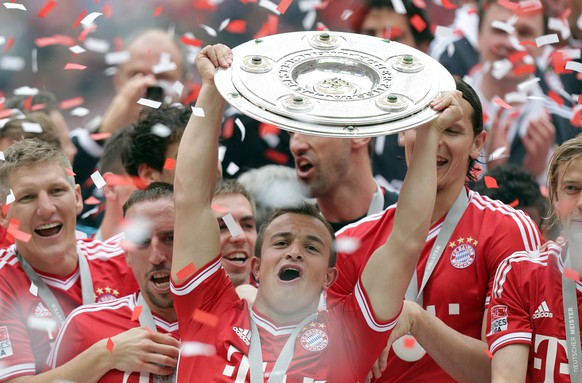 Munich's Xherdan Shaqiri of Switzerland  lifts the trophy for winning the German Soccer Championships after the season's last home match between FC Bayern Munich and FC Augsburg, in Munich, southern Germany, Saturday, May 11, 2013. (AP Photo/Matthias Schrader)