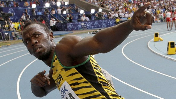 FILE - In this Aug. 18, 2013 file photo, Jamaica's Usain Bolt celebrates winning his third gold medal in the men's 4x100-meter relay at the World Athletics Championships in the Luzhniki stadium in Moscow, Russia. Competing in just one event, Bolt is likely to race in Glasgow for less than 20 seconds. Just convincing the sprint star to come to the Commonwealth Games, though, should go a long way to elevating the status of a sporting spectacle that might seem anachronistic. Two years after the exuberance of the London Olympics, where Bolt left with three golds, Britain is welcoming the world back this week - or former members of the British Empire at least - for Scotland's largest-ever multi-sports event.  (AP Photo/David J. Phillip, File)