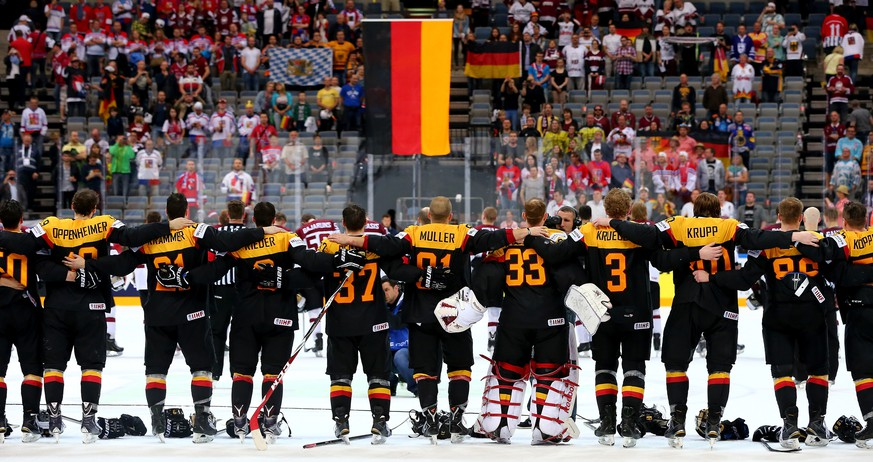 PRAGUE, CZECH REPUBLIC - MAY 08:  The team of Germany celebrate victory after the IIHF World Championship group A match between Czech Republic and Austria at o2 Arena on May 8, 2015 in Prague, Czech Republic.  (Photo by Martin Rose/Getty Images)