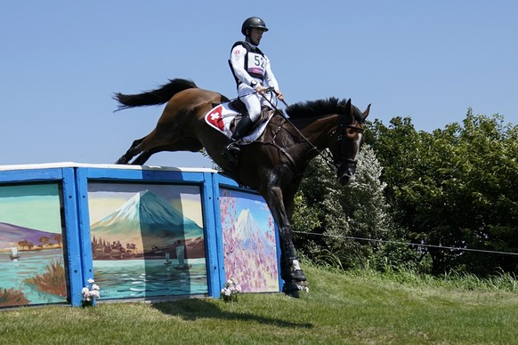Switzerland's Robin Godel, riding Jet Set, competes during the Equestrian Eventing Cross Country competition at the Sea Forest Cross Country Course during the 2020 Summer Olympics, Sunday, Aug. 1, 2021, in Tokyo, Japan. (AP Photo/Carolyn Kaster) Robin Godel