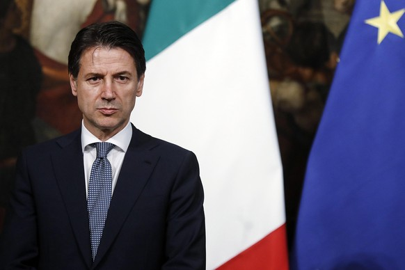 epa06804708 Italian premier Giuseppe Conte during the oath of the undersecretaries of the new government in Rome, Italy, 13 June 2018.  EPA/Riccardo Antimiani