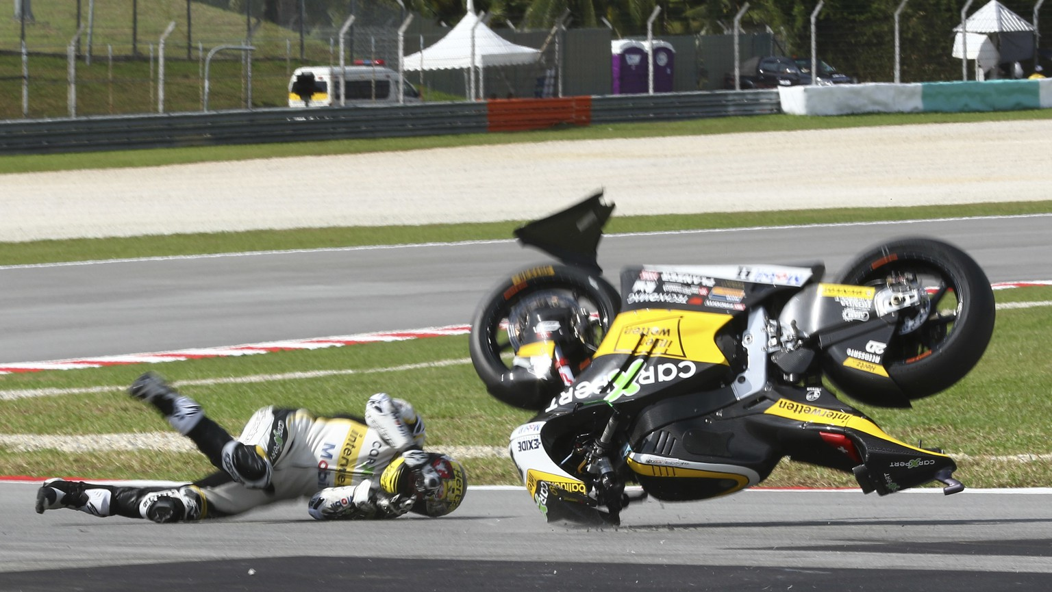 Switzerland's Moto2 rider Thomas Luthi crashes during the qualifying session of the Malaysia Moto2 at the Sepang International circuit in Sepang, Malaysia, Saturday, Oct. 28, 2017. (AP Photo/Vincent Phoon)