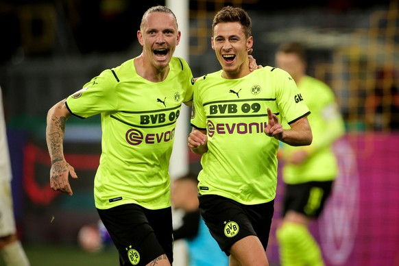 epa09547718 Dortmund's Thorgan Hazard (R) celebrates with his teammate Marius Wolf (L) after scoring the 2-0 lead during the German DFB Cup second round soccer match between Borussia Dortmund and FC Ingolstadt in Dortmund, Germany, 26 October 2021.  EPA/FRIEDEMANN VOGEL CONDITIONS - ATTENTION: The DFB regulations prohibit any use of photographs as image sequences and/or quasi-video.