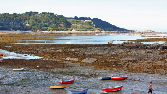 This Sept. 3, 2013 photo shows brightly colored rowboats beached in Guernsey, one of the Channel Islands in the waters between England and France. The scene is one of many that can be enjoyed on a bike tour of the area offered while in port on a cruise. (AP Photo/Charmaine Noronha)