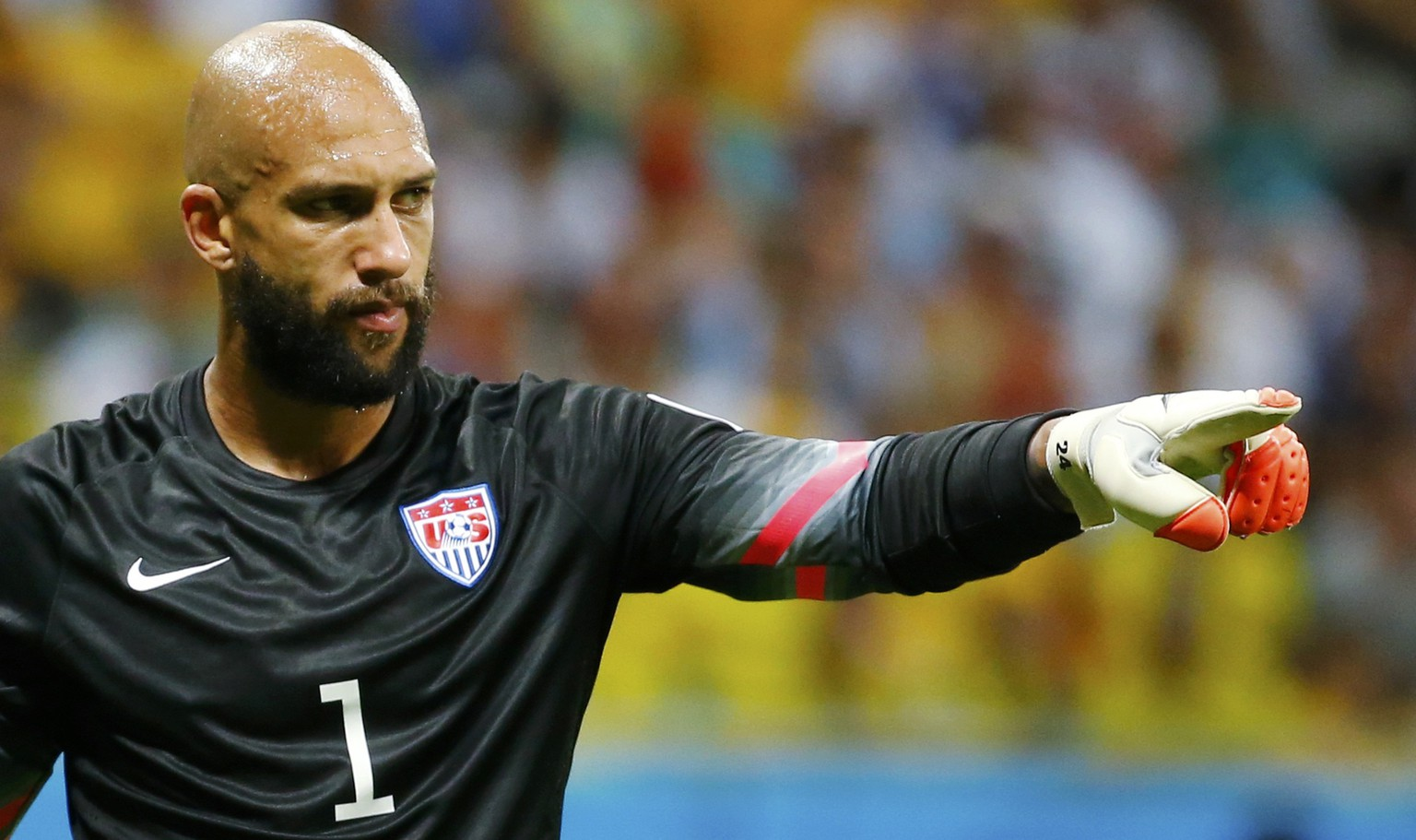 Goalkeeper Tim Howard of the U.S. gestures during their 2014 World Cup round of 16 game against Belgium at the Fonte Nova arena in Salvador July 1, 2014. REUTERS/Yves Herman (BRAZIL  - Tags: SOCCER SPORT WORLD CUP)