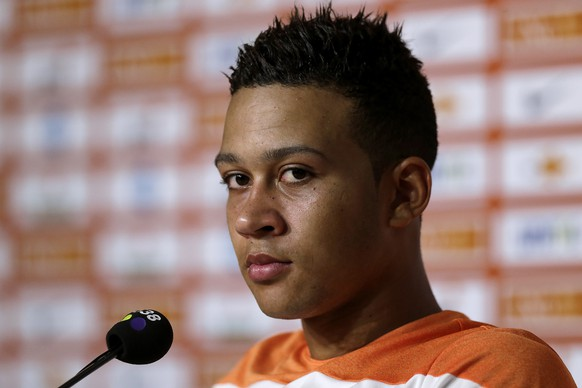 Memphis Depay of the Netherlands listens during a press conference held after a training session in Rio de Janeiro, Brazil, Tuesday, June 24, 2014. Netherlands will play Group A runner-up Mexico in the second round on Sunday in Fortaleza. (AP Photo/Wong Maye-E)