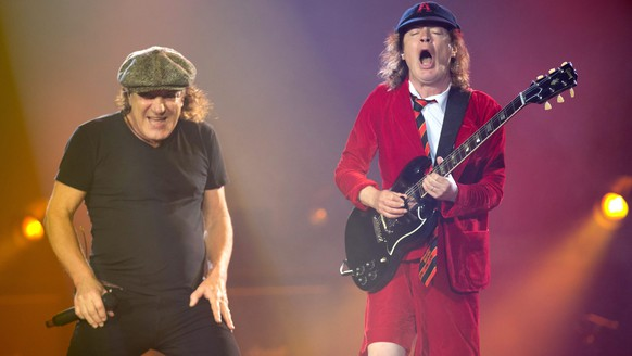 epa04844569 Singer Brian Johnson (L) and lead guitarist Angus Young (R) of rock legends AC/DC perform at Veltins Arena stadium in Gelsenkirchen, Germany, 12 July 2015.  EPA/FRISO GENTSCH