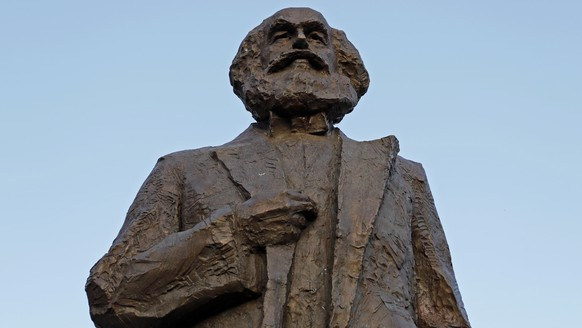 epa06713771 A view of the Karl Marx statue in Trier, Germany, 05 May 2018. China donated the Karl Marx statue, by Chinese sculptor Wu Weishan, to the city of Trier, the birthplace of the philosopher, for the jubilee year 2018.  On 05 May 2018 marks the 200th year anniversary of the birth of German philosopher, economist, historian, political theorist, sociologist, journalist and revolutionary socialist Karl Marx, who co-wrote and published the pamphlet 'The Communist Manifesto' and wrote the materialist philosophical text 'Das Kapital'.  EPA/RONALD WITTEK
