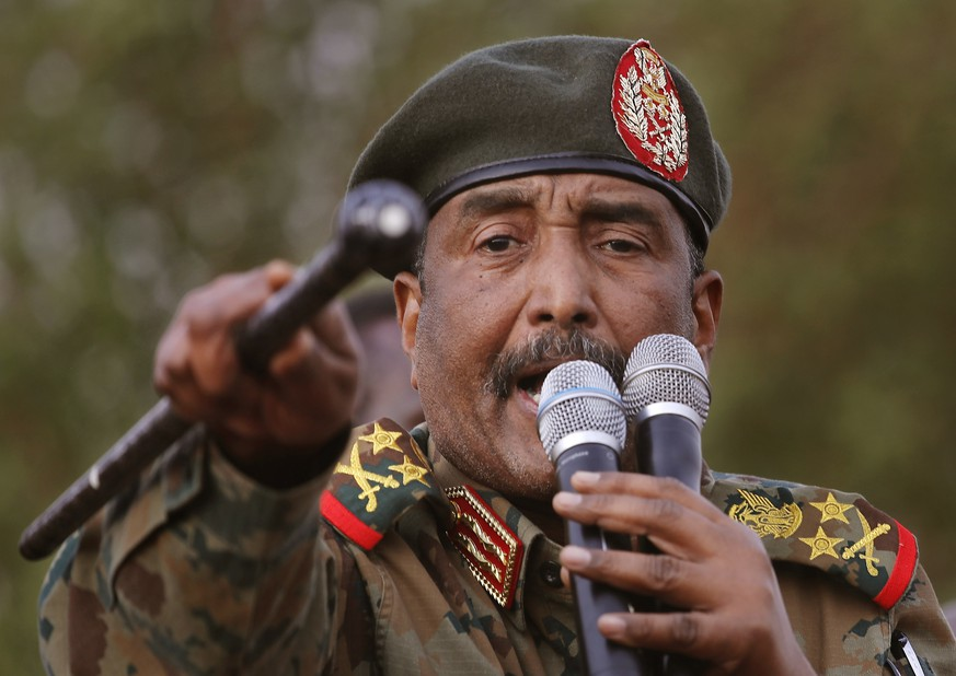 FILE - In this June 29, 2019 file photo, Sudanese Gen. Abdel-Fattah Burhan, head of the military council, speaks during a military-backed rally, in Omdurman district, west of Khartoum, Sudan. Officials in Sudan confirmed that a senior U.S.-Israeli delegation flew to Sudan on a private jet Wednesday, Oct. 21, 2020, and met with Burhan and others to wrap up a deal that would make Sudan the third Arab country to normalize ties with Israel this year. (AP Photo/Hussein Malla, File) Abdel-Fattah Burhan