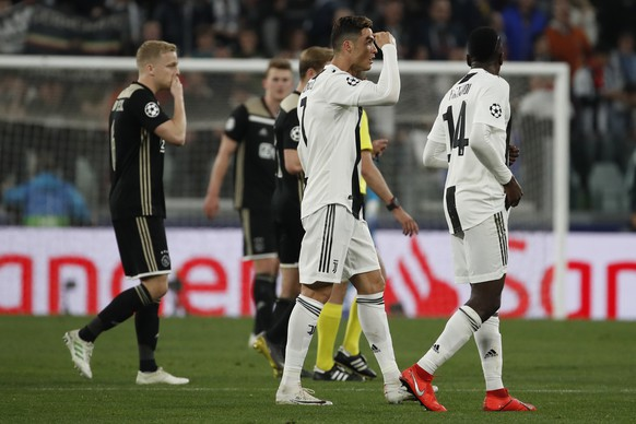 Juventus' Cristiano Ronaldo, center, celebrates after scoring his side's opening goal during the Champions League quarter final, second leg soccer match between Juventus and Ajax, at the Allianz stadium in Turin, Italy, Tuesday, April 16, 2019. (AP Photo/Antonio Calanni)