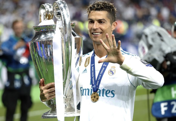 FILE - In this Saturday, May 26, 2018 file photo Real Madrid's Cristiano Ronaldo celebrates with the trophy after winning the Champions League Final soccer match between Real Madrid and Liverpool at the Olimpiyskiy Stadium in Kiev, Ukraine. Cristiano Ronaldo says it was his