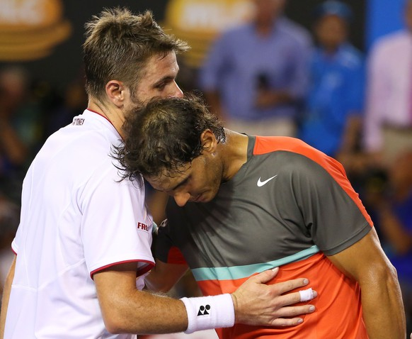 MELBOURNE, AUSTRALIA - JANUARY 26:  Stanislas Wawrinka of Switzerland and Rafael Nadal of Spain hug at the net after Wawrinka won their men's final match during day 14 of the 2014 Australian Open at Melbourne Park on January 26, 2014 in Melbourne, Australia.  (Photo by Scott Barbour/Getty Images)