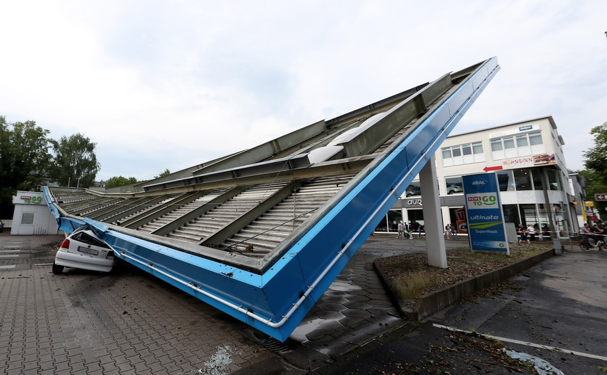 epa06771807 A general view on a gas station which's roof was torn down by a storm in Wuppertal, Germany, 29 May 2018. The German Meteorological Service (DWD) has issued severe weather warnings due to strong winds and heavy rain.  EPA/FRIEDEMANN VOGEL