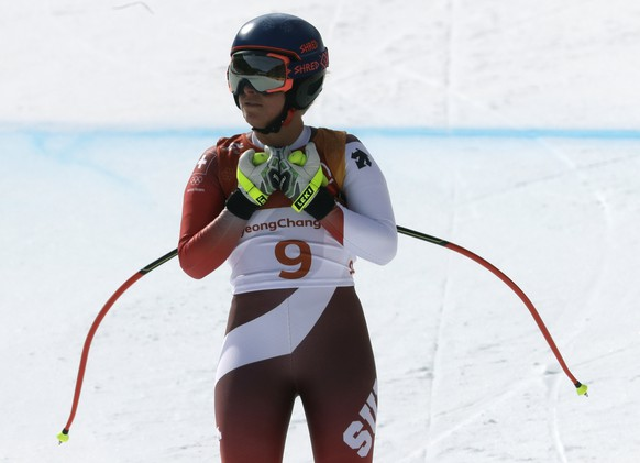 Switzerland's Lara Gut stands after competing in the women's downhill at the 2018 Winter Olympics in Jeongseon, South Korea, Wednesday, Feb. 21, 2018. (AP Photo/Michael Probst)