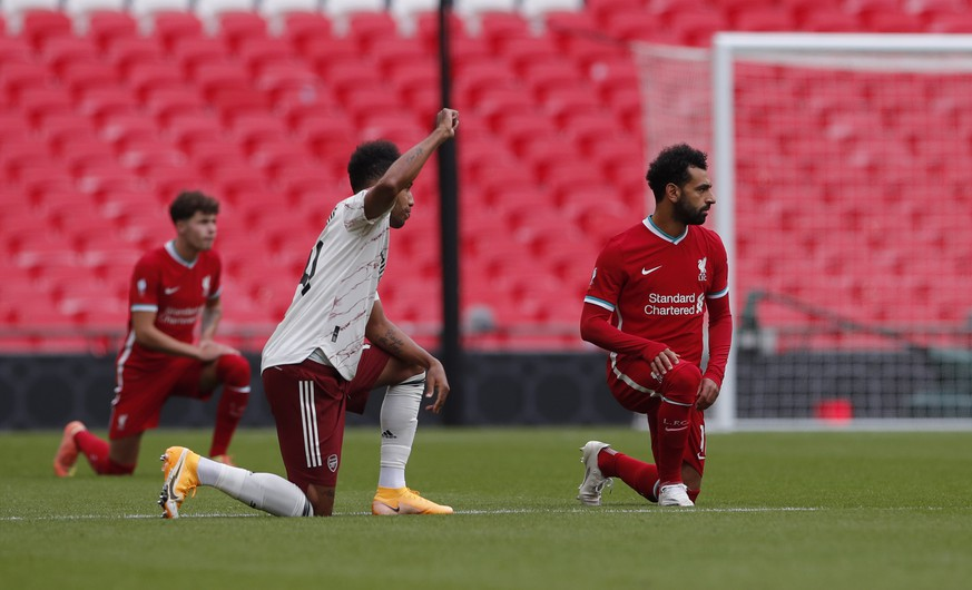 Players take a knee in support of the Black Lives Matter movement before the English FA Community Shield soccer match between Arsenal and Liverpool at Wembley stadium in London, Saturday, Aug. 29, 2020. (Andrew Couldridge/Pool via AP)