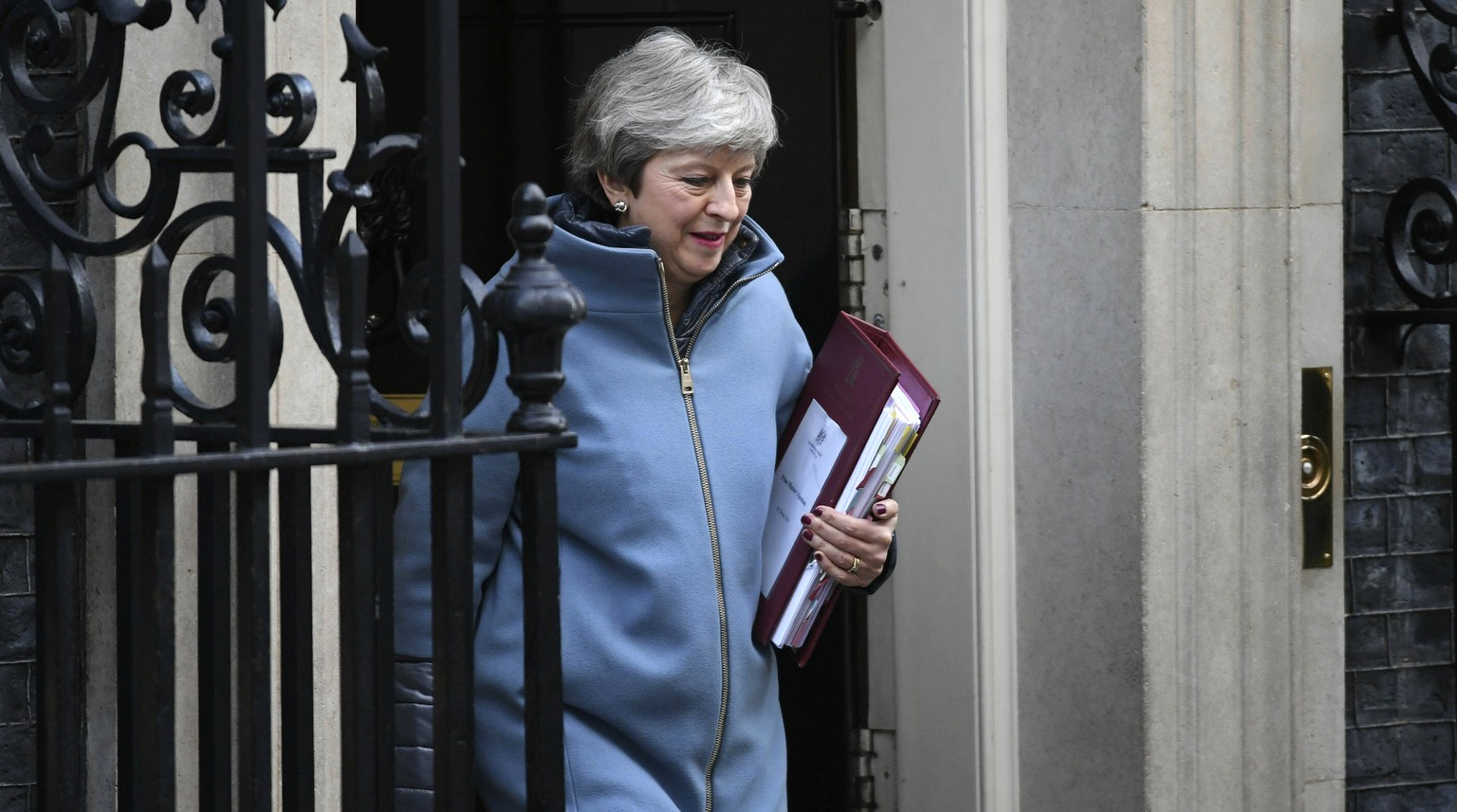 "British Prime Minister Theresa May leaves 10 Downing Street, London, for the House of Commons to face Prime Minister's Questions, in London Wednesday, Feb. 20, 2019. Britain's foreign secretary said that securing an orderly Brexit is ""of paramount importance"" as he visited Germany on Wednesday, and insisted the UK can leave the European Union on March 29 as planned if a compromise deal is found. Jeremy Hunt was meeting officials in Berlin ahead of Prime Minister Theresa May's trip to Brussels later Wednesday for talks with EU Commission President Jean-Claude Juncker. (Stefan Rosseau/PA via AP)"