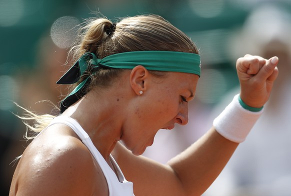 France's Kristina Mladenovic clenches her fist as she plays Spain's Garbine Muguruza during their fourth round match of the French Open tennis tournament at the Roland Garros stadium, Sunday, June 4, 2017 in Paris. (AP Photo/Petr David Josek)