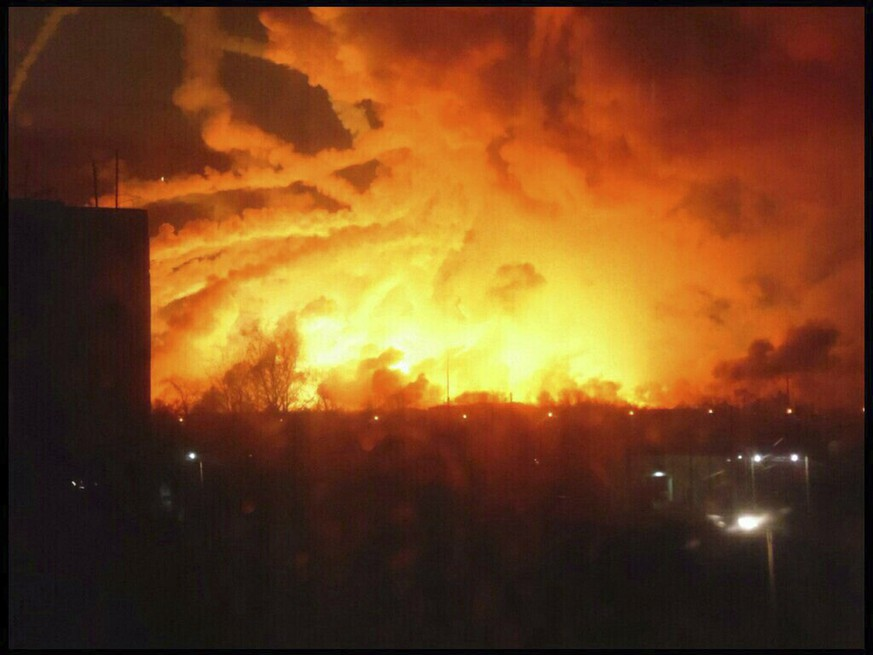 This photo provided by Ukrainian Emergency Situations Ministry press service a fire rages at a military ammunition depot in Balaklia near Khrakiv in Ukraine on Thursday, March 23 2017. There was no immediate information about any casualties. Ukrainian officials say the massive fire that prompted the evacuation of 20,000 has been caused sparked by sabotage.. (AP Photo/Ministry of Emergency Situations press service via AP)