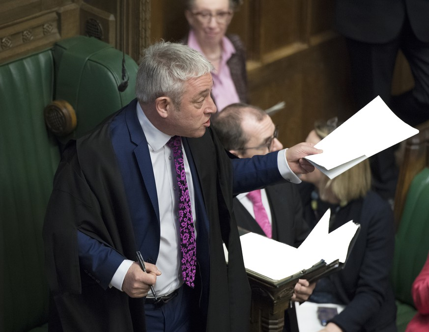 Britain's Speaker of the House John Bercow reacts during Prime Minister's Questions inside the House of Commons, London, Wednesday Feb. 13, 2019.  The British government on Wednesday downplayed news reports with rumours of a possible delay in the U.K.'s exit from the European Union. (UK Parliament, Jessica Taylor via AP)