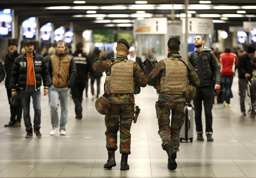 Belgian soldiers patrol in the arrival hall at Midi railway station in Brussels, November 21, 2015, after security was tightened in Belgium following the fatal attacks in Paris. Belgium raised the alert status for its capital Brussels to the highest level on Saturday, shutting the metro and warning the public to avoid crowds because of a