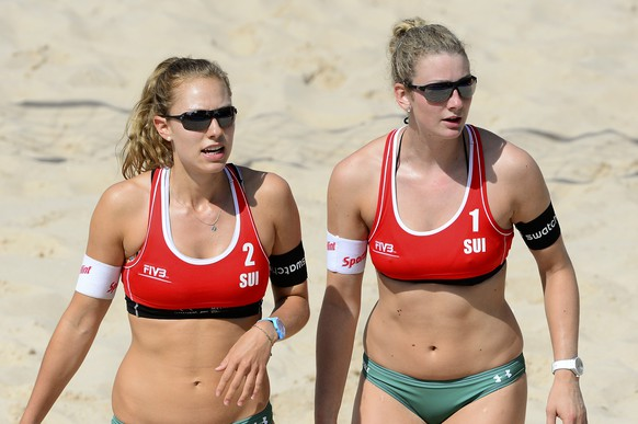 *** CAPTION CORRECTION - CORRECTS POSITION *** Nicole Eiholzer, right, and Nina Betschart, left, of Switzerland, during the game against Maria Prokopeva and Ekaterina Syrtseva, of Russia, not pictured, in a Main Draw Match during the Beachvolley Worldtour on Wednesday, May 13, 2015 in Lucerne, Switzerland. (KEYSTONE/Urs Flueeler) *** CAPTION CORRECTION - CORRECTS POSITION