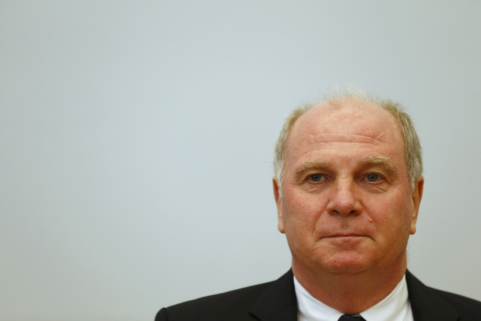 Bayern Munich President Uli Hoeness arrives for the second day of his trial for tax evasion at the regional court in Munich March 11, 2014. Hoeness stunned a German court on Monday by admitting he had evaded taxes of 18.5 million euros ($26 million) using a secret Swiss bank account - more than five times the amount on a prosecutors' charge sheet.  Once one of Germany's most admired managers, Hoeness apologised and appealed for leniency at the start of a trial in a case that shocked Germany and prompted other tax dodgers to turn themselves in. Hoeness could be sentenced to between five and 10 years in jail if convicted of evading more than 1 million euros in taxes.                             REUTERS/Michael Dalder (GERMANY  - Tags: SPORT SOCCER CRIME LAW BUSINESS TPX IMAGES OF THE DAY)