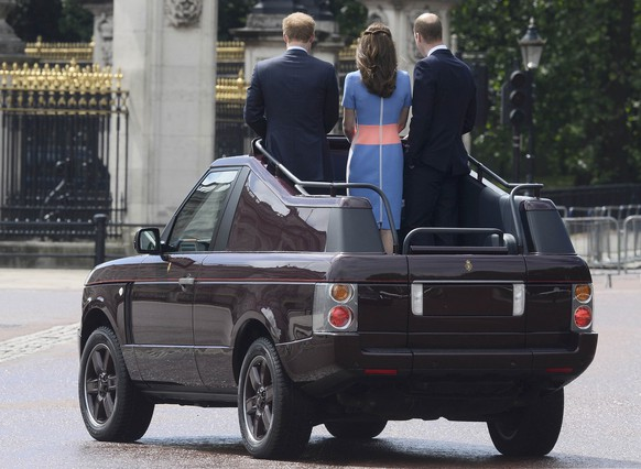 Britain's Princes William, Harry and Kate Duchess of Cambridge ride an open top Range Rover as they greet guests attending the Patron's Lunch on the Mall, an event to mark Queen Elizabeth's 90th birthday, in London, June 12, 2016.    REUTERS/Toby Melville