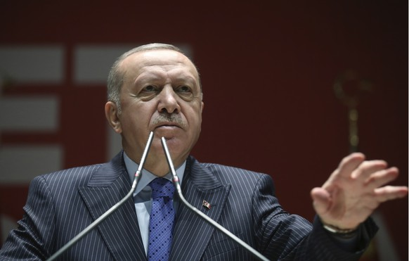 Turkish President Recep Tayyip Erdogan speaks to his ruling party members, in Ankara, Turkey, Thursday, Feb. 27, 2020. Erdogan said Thursday that fighting in northwest Syria had swung in favor of Turkey and the opposition forces it supports. (Presidential Press Service via AP, Pool)