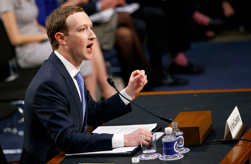 FILE- In this Tuesday, April 10, 2018, file photo, Facebook CEO Mark Zuckerberg testifies before a joint hearing of the Commerce and Judiciary Committees on Capitol Hill in Washington. Zuckerberg repeatedly assured lawmakers Tuesday and Wednesday that he didn't believe the company violated its 2011 agreement with the Federal Trade Commission to overhaul its privacy practices. (AP Photo/Carolyn Kaster, File)