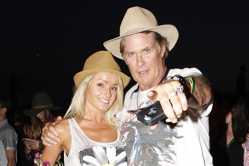 Indio, CA - David Hasselhoff and his girlfriend Hayley Roberts enjoy Coachella and pose up for photos.  The couple wore matching hats and smiles.